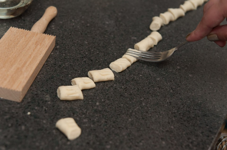 If you don't have a fancy gnocchi board you can use a fork. Gently indent your gnocchi.